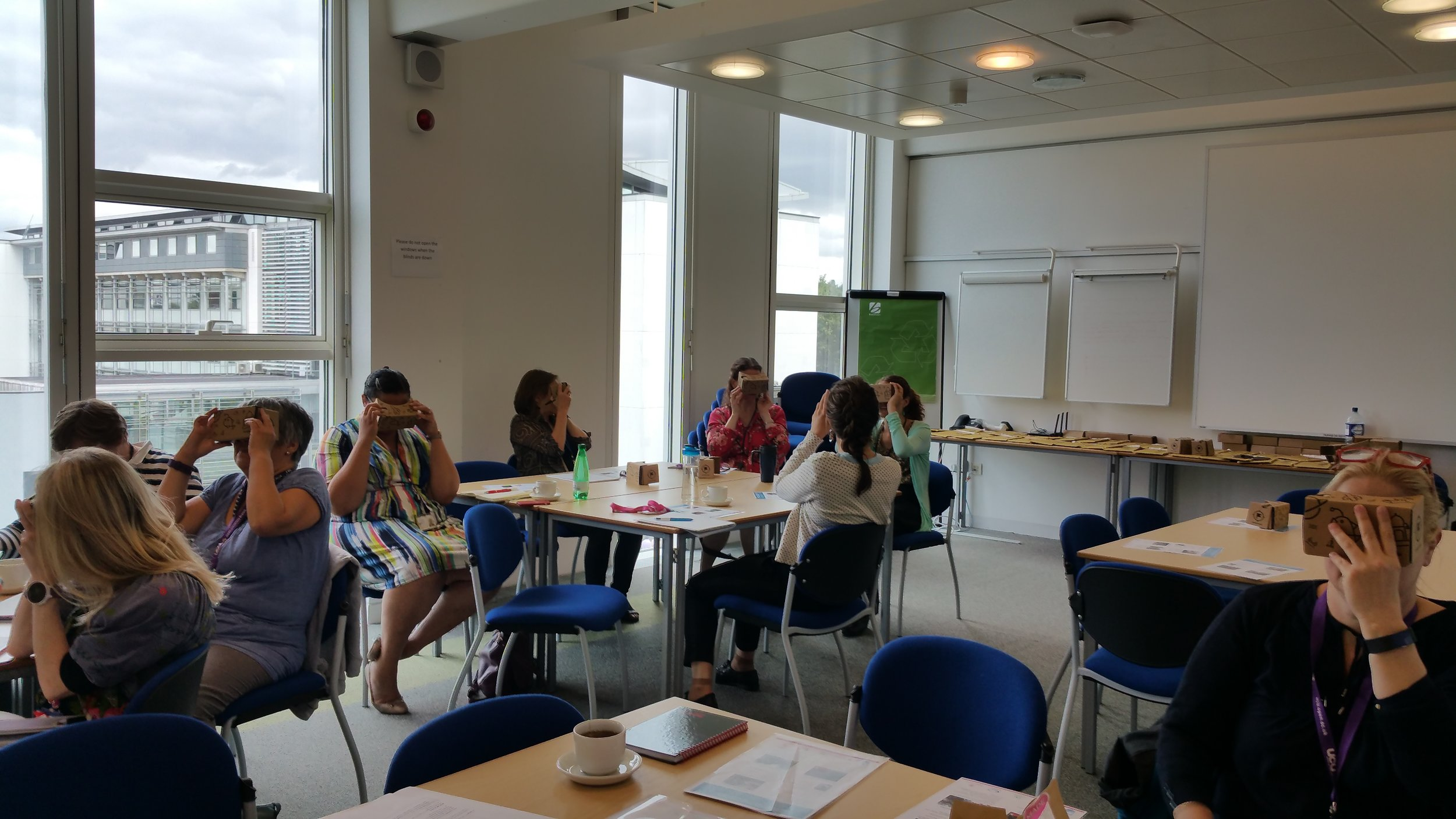 Photo from the workshop of the Employability and Scholarship Network of The Open University, UK. Participants are looking at Google Expeditions via the virtual reality viewers.