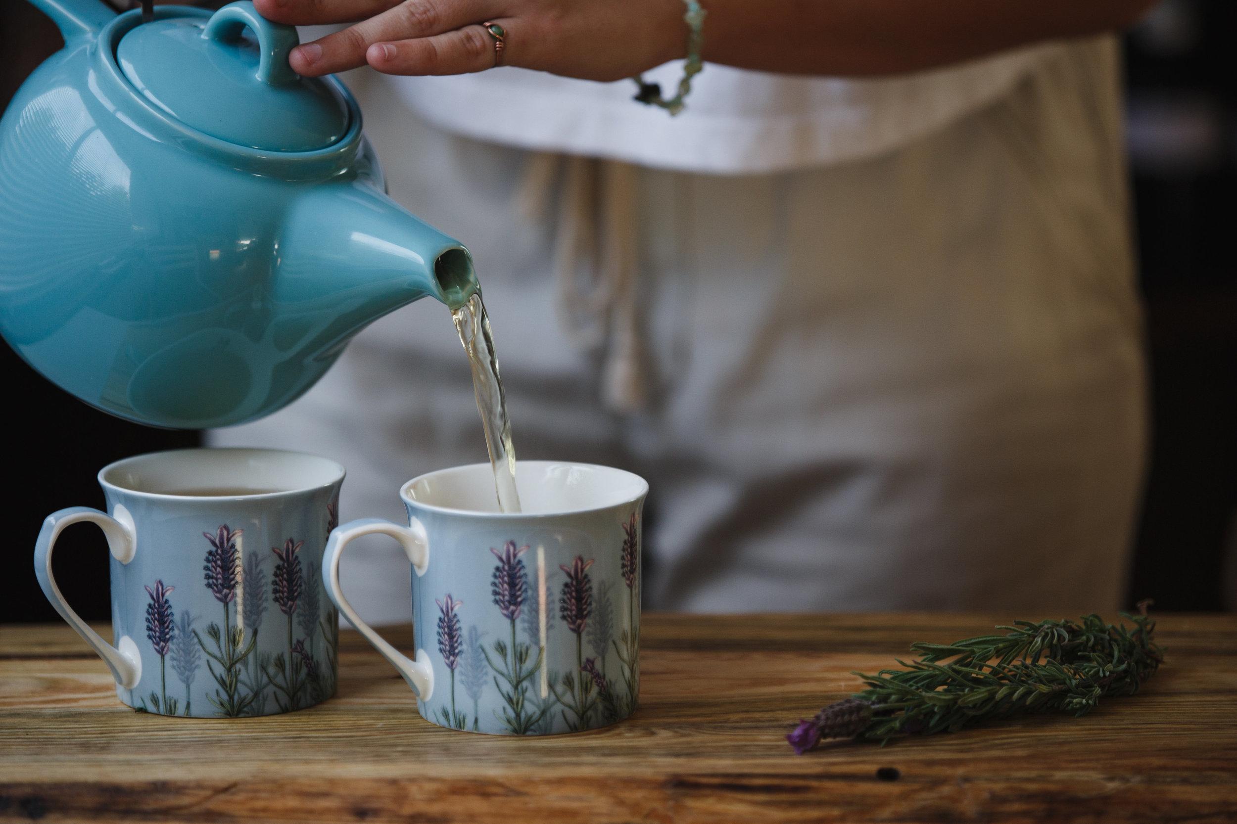 Medicinal tea being poured