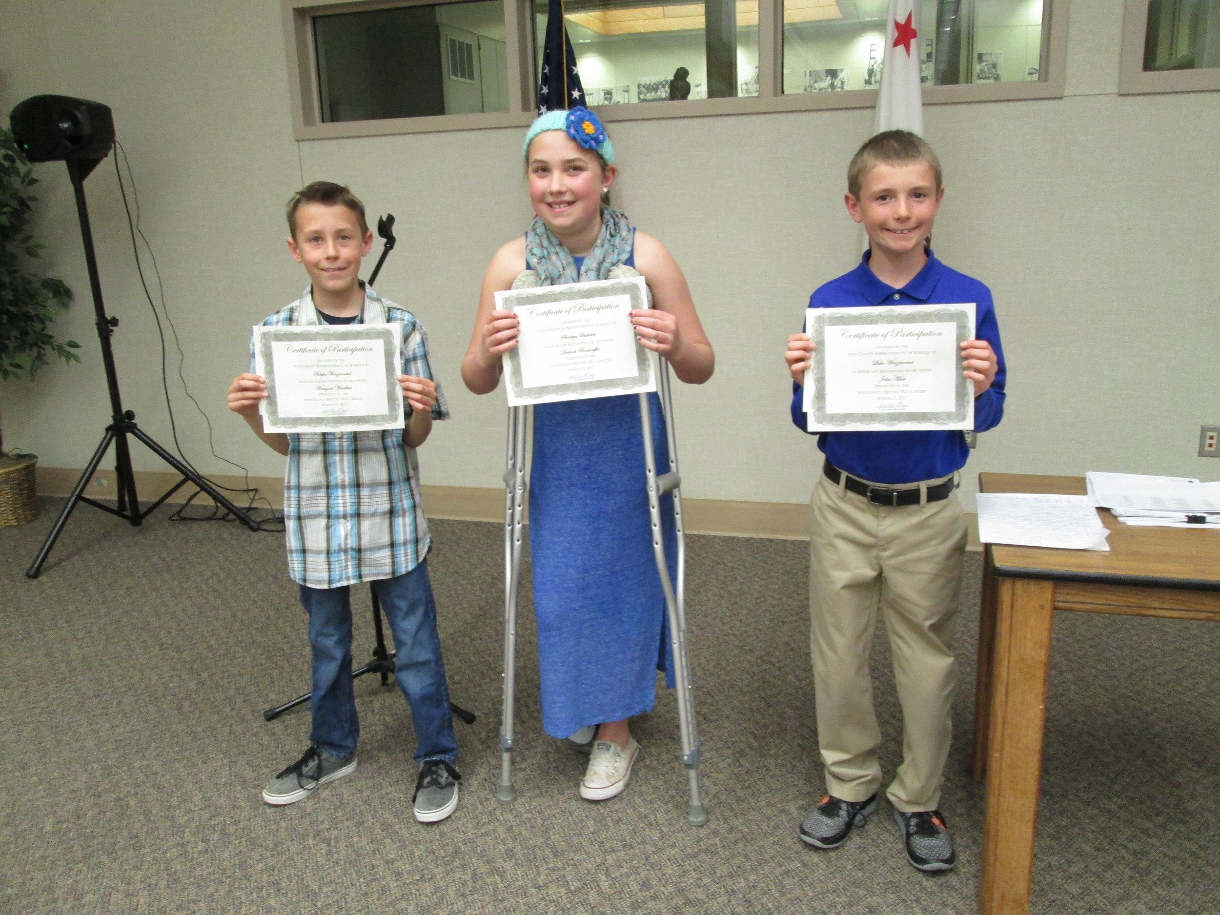 Caption: Winners Blake Winzenread, Shealyn Ludwick, and Luke Winzenread