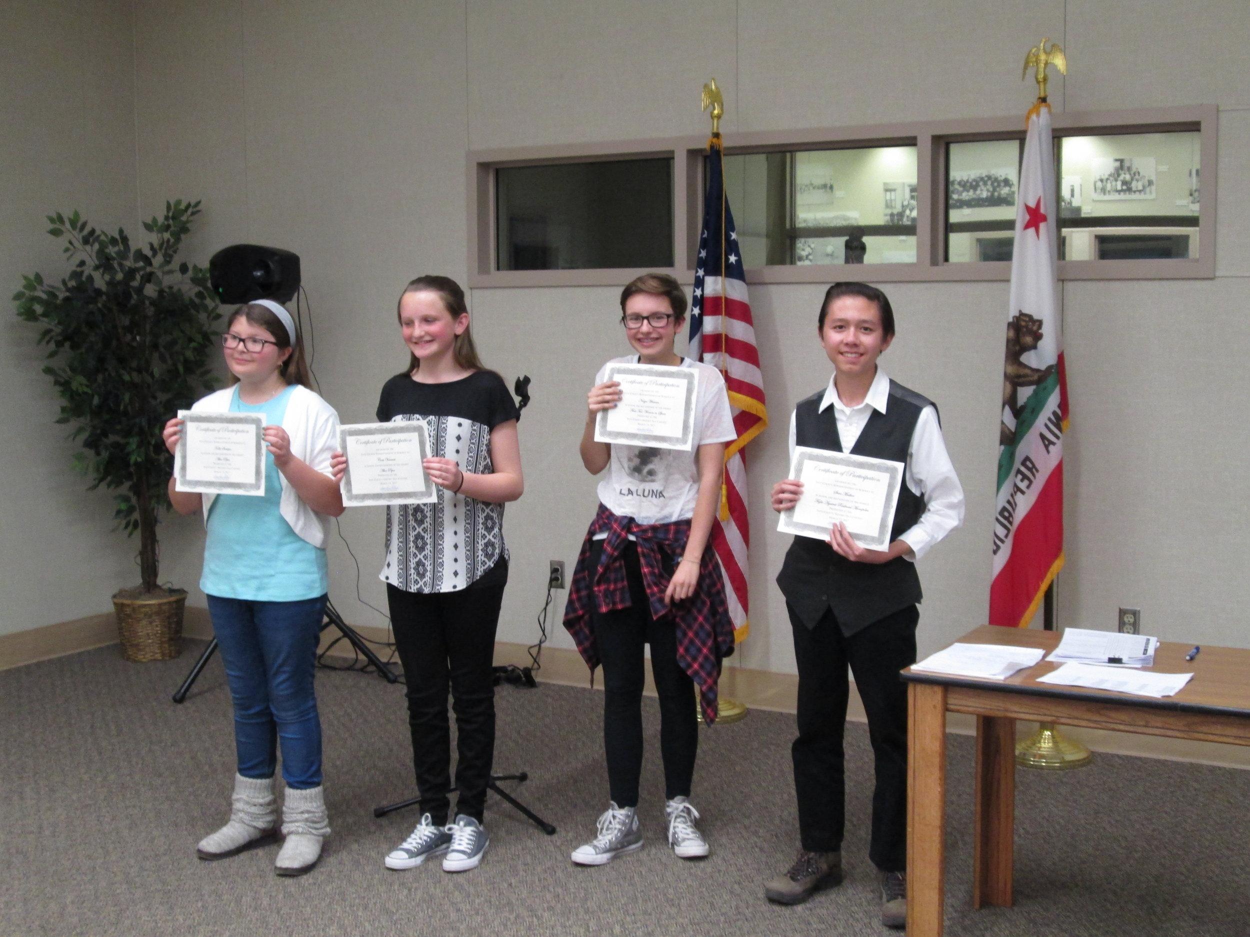 Caption: Winners Kaki Saulque, Cora VanNest, Naiya Warren, and Steven Mather