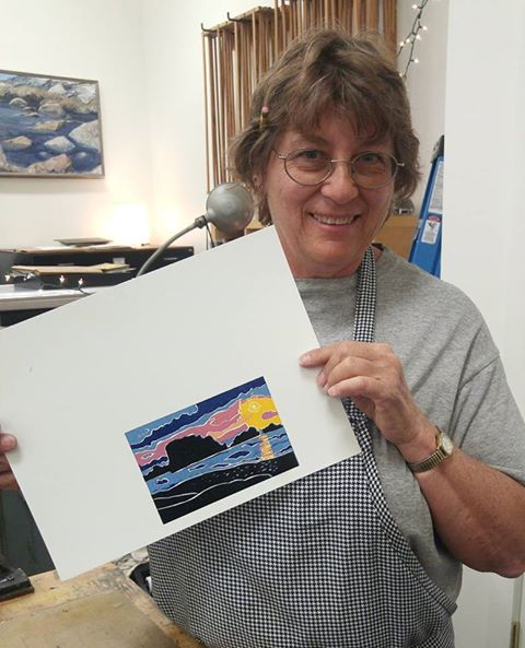Beverly Schroeder with her seven-color lino block print, photo by Kyle Holland.jpg