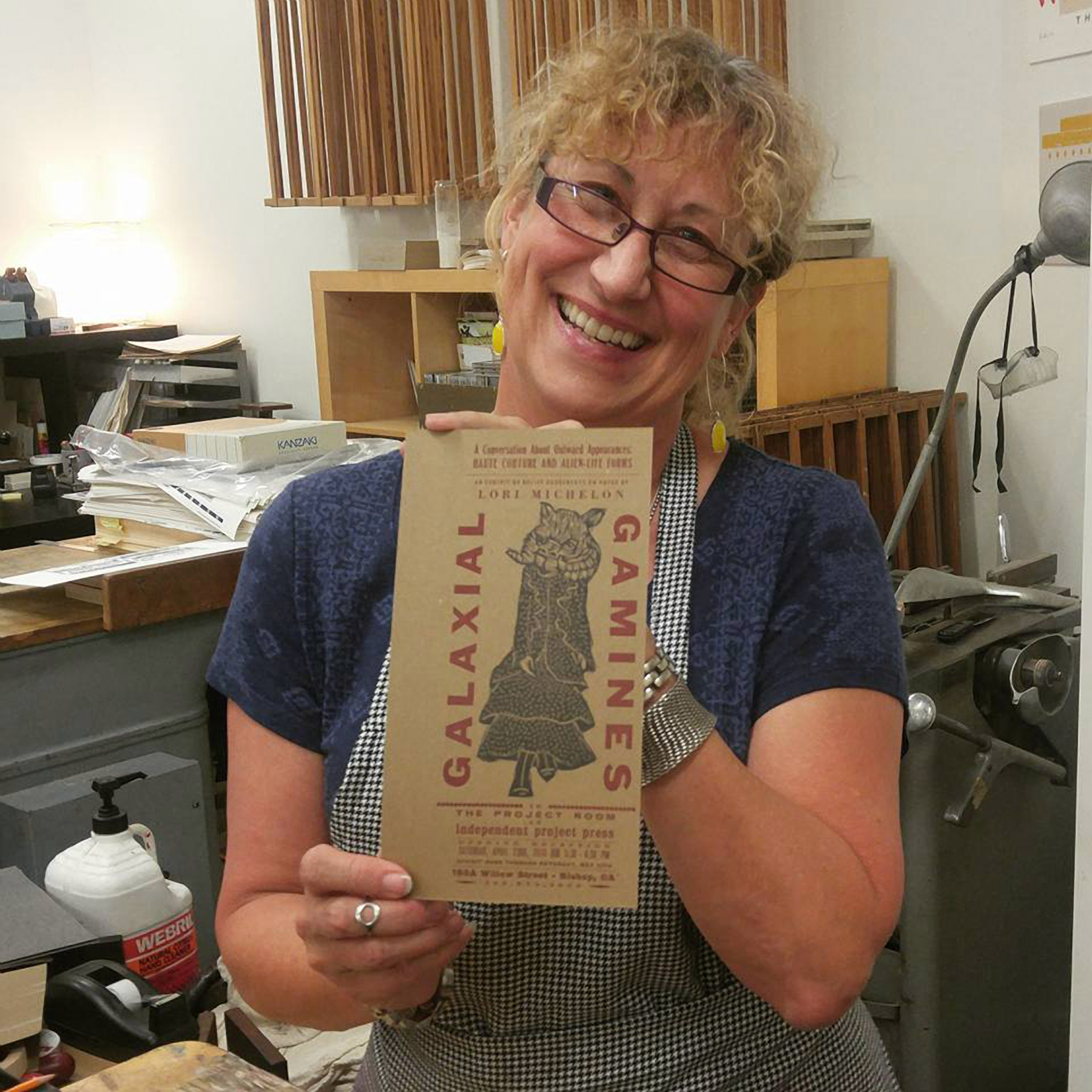 Lori Michelon printing her Galaxial Gamines exhibition announcement card, photo by Kyle Holland.jpg