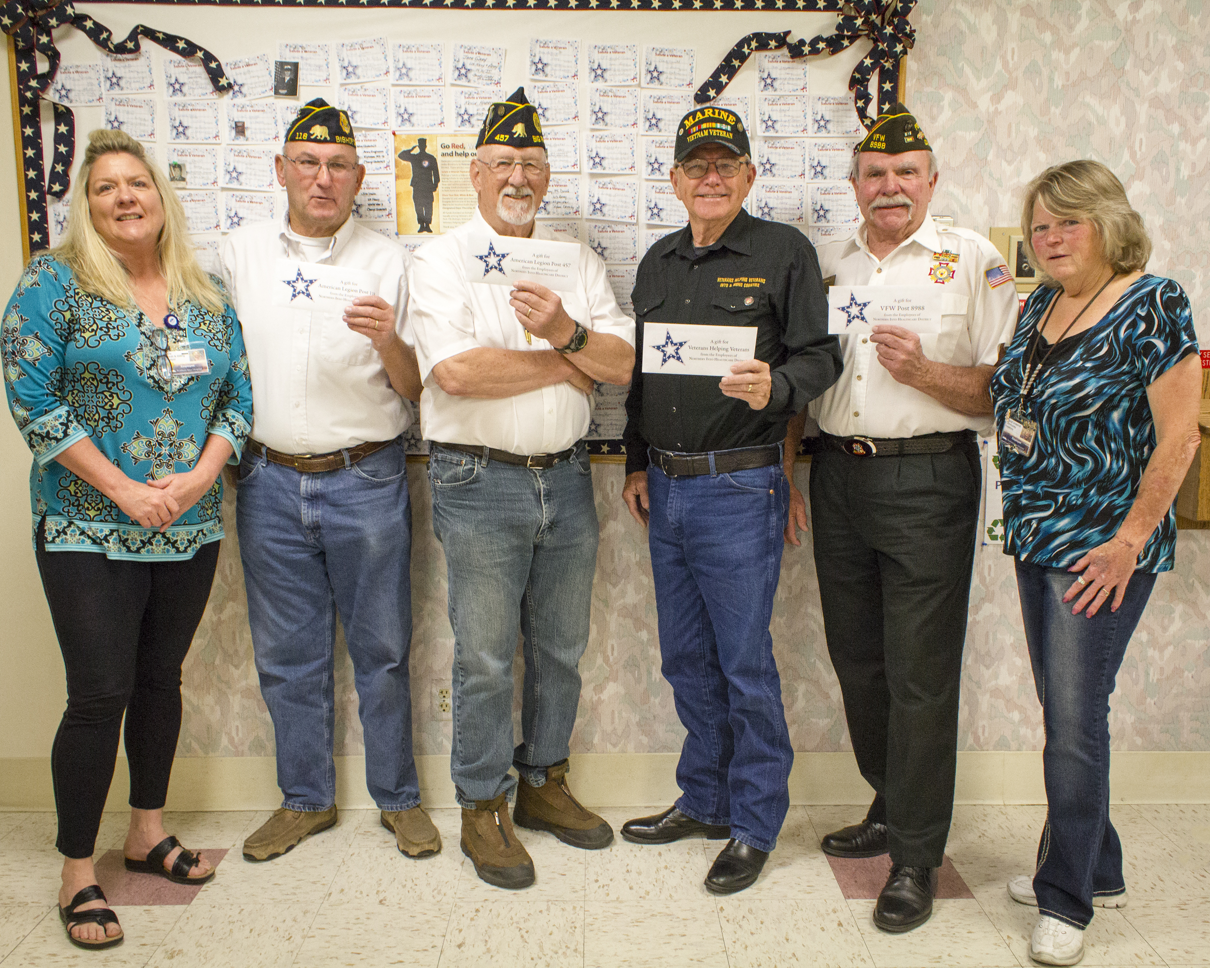 Northern Inyo Healthcare District employees recently raised $800 for four local veterans organizations. Shown here are Lorie Thompson, NIHD's Veterans Administration Liaison; Paul Sanders, Commander of American Legion Post 118, Bishop; Rick Fields, Commander of American Legion Post 457, Big Pine; Dan Stone, Veterans Helping Veterans; Jim Snyder, Commander, Veterans of Foreign Wars Post 8988; and, Cheryl Underhill, NIHD Community Relations. Photo by Barbara Laughon/Northern Inyo Healthcare District
