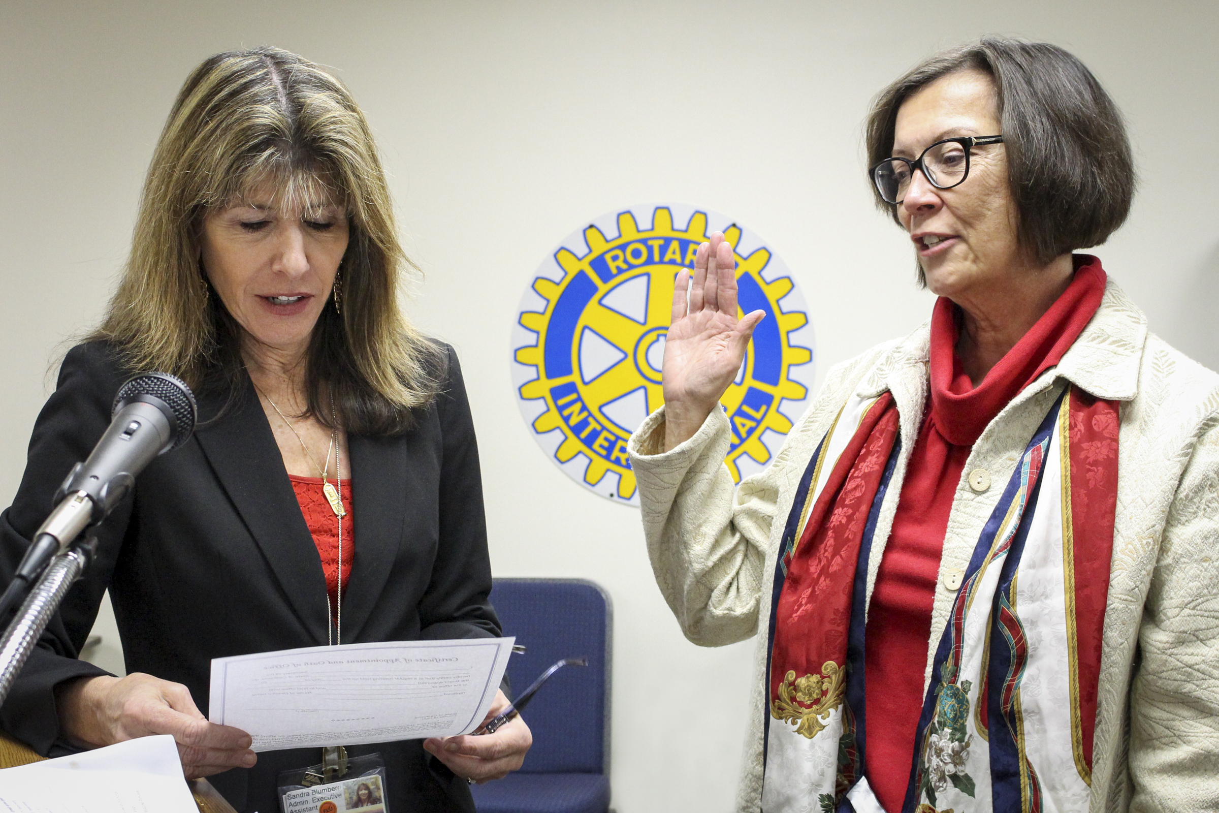 Jean Turner, right, NIHD's newest member to its Board of Directors, is sworn into office Wednesday evening by NIHD Board Secretary Sandy Blumberg. Photo by Barbara Laughon/Northern Inyo Healthcare District