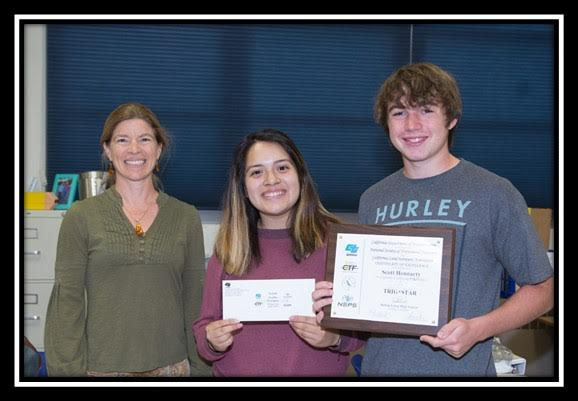 Seryna Cagle of Caltrans with students Jeniffer Valezquez and Scott Hennarty who received a certificate and prize for placing in the Bishop Union High School Trig*Star competition.