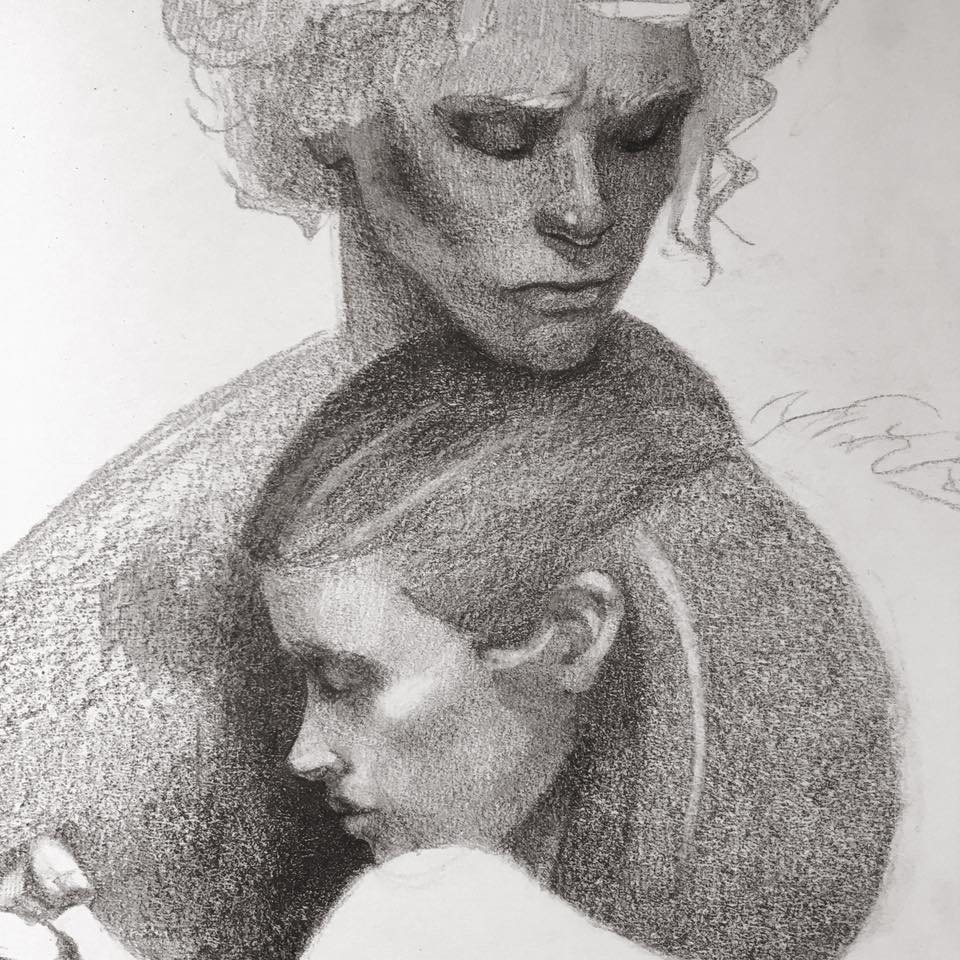 Detailing the facial structures with layers of graphite.