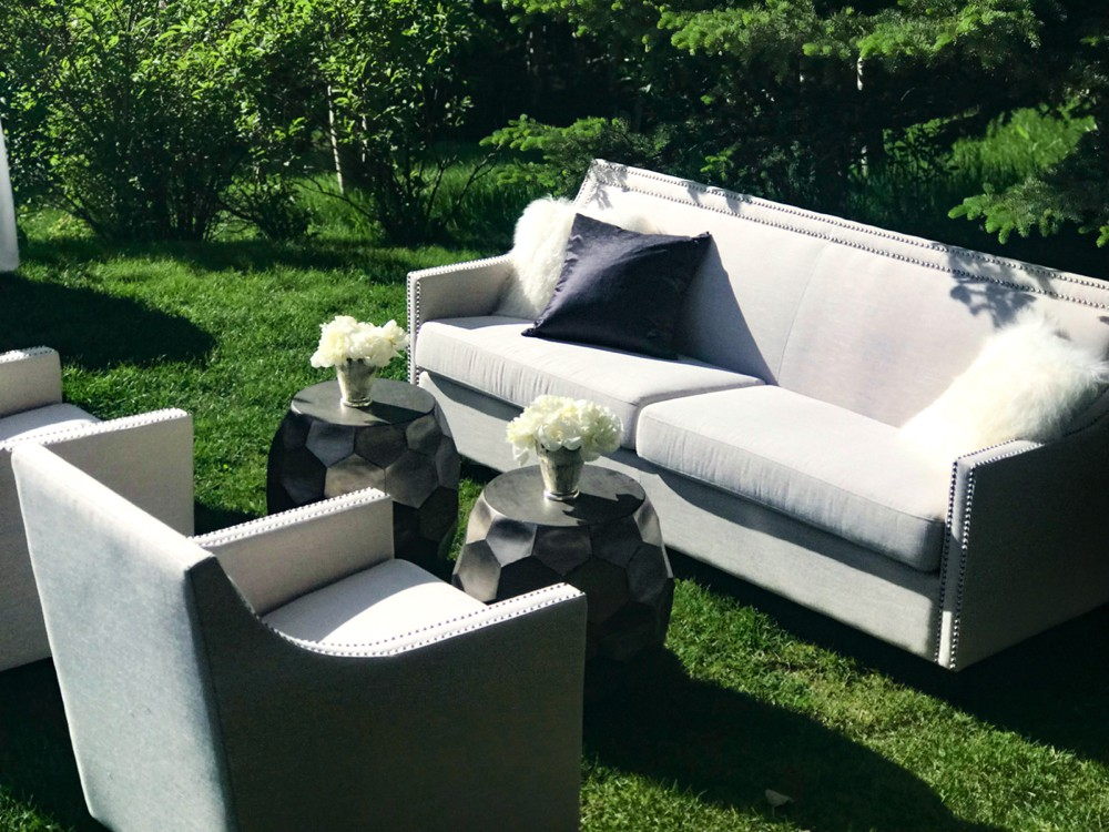 beautiful green grass with couches wedding.jpg