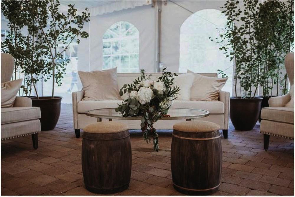Wedding arrangement with creative and playful ottomans.jpg