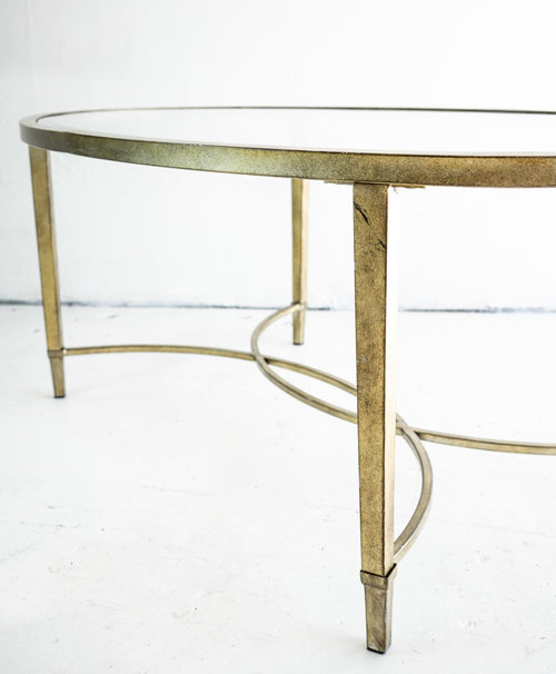 gold and glass oval coffee table.jpg