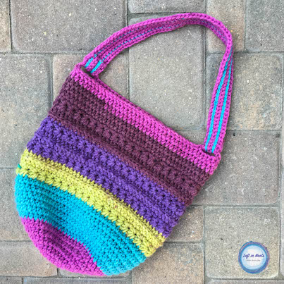 One cake of Bernat Pop yarn is all you need to make this cute and functional bag! Perfect for carrying projects, farmer's markets, library trips and more. Read more for the free crochet pattern :)