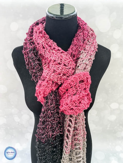 Treat yourself to some beautiful yarn and make this luxurious Ric Rac Wrap! This free crochet pattern uses simple stitches and is a perfect oversized wrap or scarf.