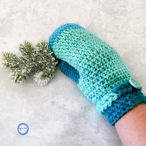 Take out one skein of yarn and make a pair of beautiful, warm mittens to add to your gifting stash! The Frozen Fingers Mittens are a free crochet pattern featuring Premier Sweet Roll yarn and are part of the 2017 Holiday Stashdown CAL. I hope you enjoy this fast and simple pattern!