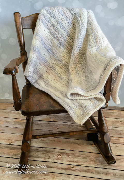 When you need a last minute baby blanket, the Dreamy Waves Baby Blanket is the perfect crochet pattern for you! This beginner friendly blanket is self-striping and made with bulky yarn so that it works up in a flash. I also include tips on how to resize this pattern so that you could even make a throw or afghan if you want to. I hope you enjoy my new free crochet pattern!