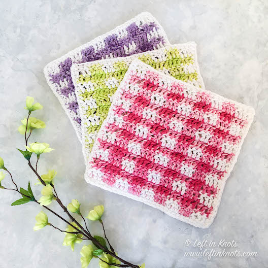 These colorful gingham dishcloths are a fast and fun way to update your decor for spring! So even if you still have snow on the ground, you can bring bright and fun colors inside. I made these dishcloths in pink, green and purple, but really you can make any color combo you want using basic worsted weight cotton yarn. Keep reading for the free crochet pattern for the Spring Gingham Dishcloths.