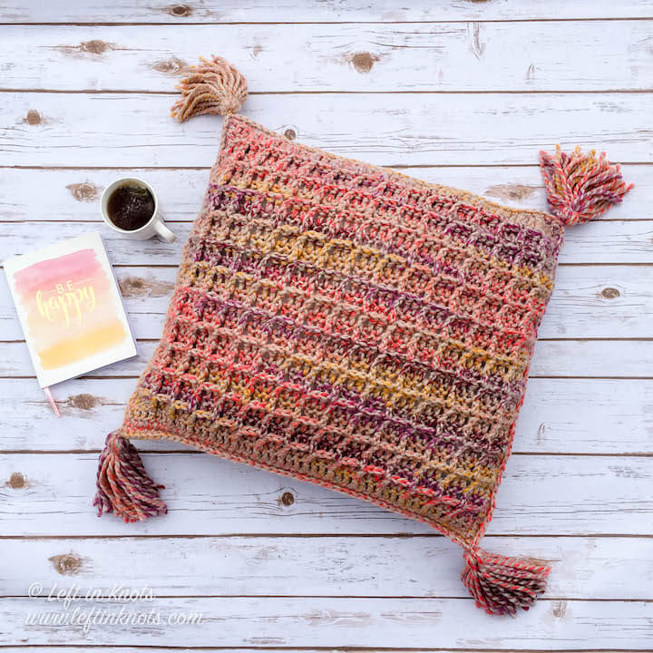This free crochet pattern uses the Waffle Stitch and tassels to make a modern, Anthropologie-inspired throw pillow with Lion Brand Wool Ease Thick and Quick. This simple crochet pattern includes a right and left handed video tutorial to teach you how to crochet the Waffle Stitch.