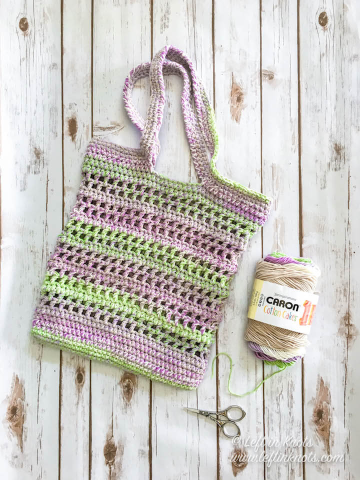 Take out your Caron Cotton Cakes for this new free crochet pattern! This free market tote bag works up beautifully AND quickly using double strands of cotton yarn. It will be a sturdy and functional bag for your WIPS, groceries, and more!