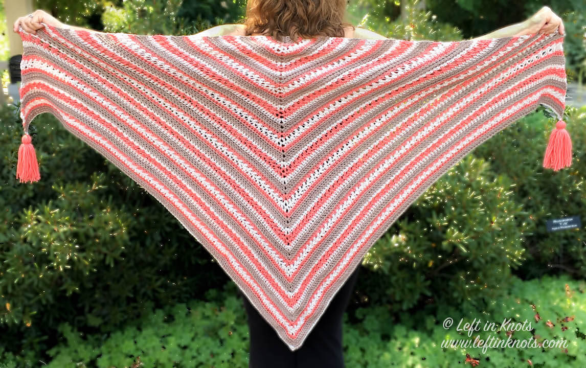 This textured triangle wrap is made with Red Heart Chic Sheep 100% Superwash Merino Wool Yarn. Wear the Breckenridge Wrap as a shawl or as a triangle scarf. This free crochet pattern will be one you will want to make for your fall and winter wardrobe!