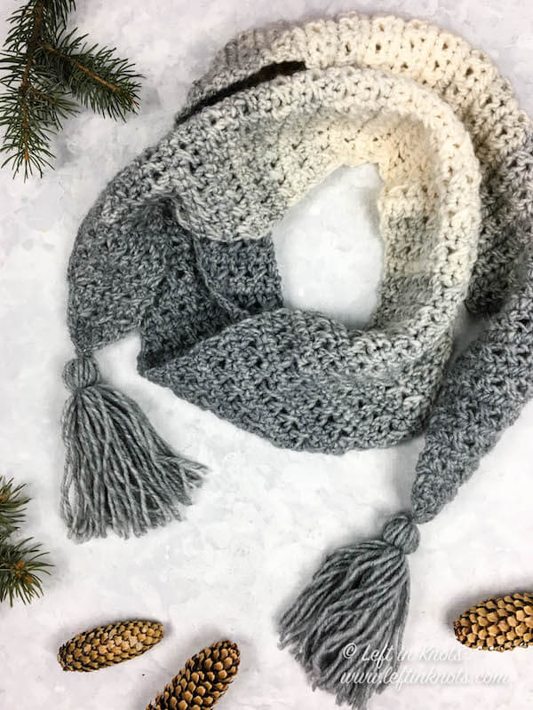 The Icicles Scarf is a one skein crochet pattern with a modern twist. The triangular shape of the edges can be embellished with tassels, fringe or pom poms. Enjoy Seven Days of Scarfie free crochet pattern #5!