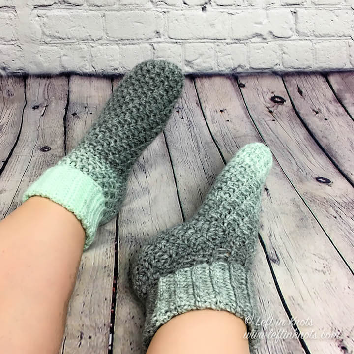 """Use the rest of your Seven Days of Scarfie """"Day 4"""" skein to crochet these coziest slipper socks! Or you may as well grab a couple of skeins, because you will want a few pairs of these for yourself too :) This free crochet pattern makes the Wintermint Slipper Socks in three sizes that will fit most adult women. The cuffed ankle keeps them in place, and the ever fuzzy Scarfie yarn will keep your feet warm for days!"""