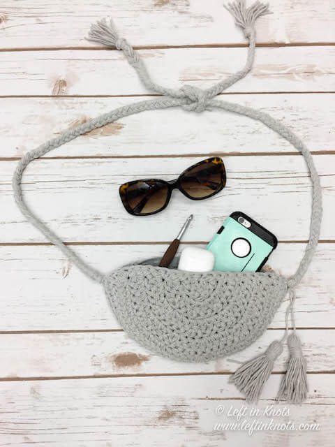 This free crochet pattern uses less that one skein of Caron Cotton Cakes to DIY your own belt bag for summer. This on-trend crochet fanny pack can store all your little essentials and can be worn with dresses, jeans or even yoga pants. Prefer purses? Make the tie strings long and use it as a crossbody bag instead.