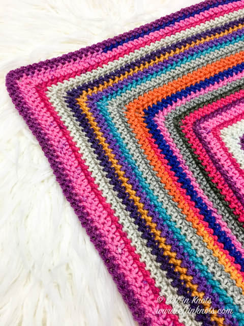 This free crochet pattern uses any mix of cake yarn from your stash to create a scrapghan style throw or blanket in any size. Use the herringbone half double crochet stitch in the round to add texture.