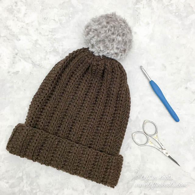 This beginners crochet hat is made with a simple rectangle, and it uses less than one skein of yarn for any size. This free crochet pattern is completely customizable, and it includes step-by-step instructions to help you with assembly.