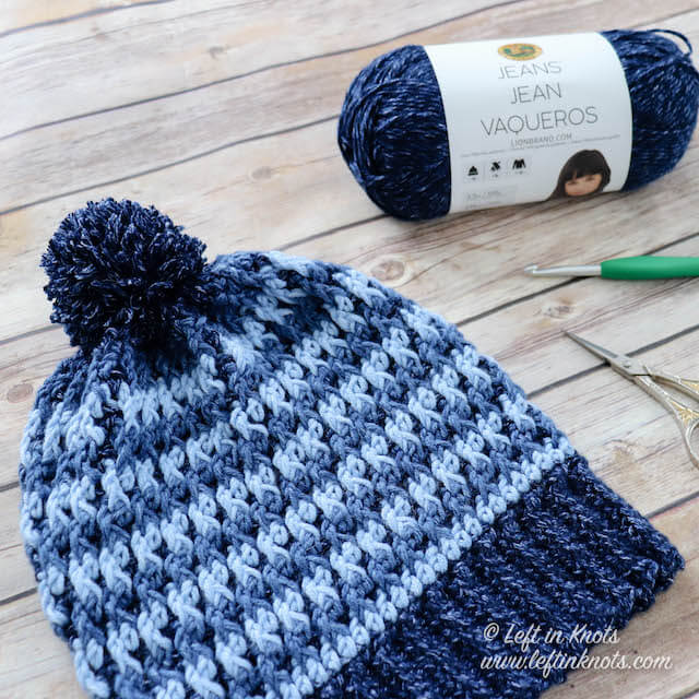 This free crochet pattern uses texture and color to create a hat that you will want for your fall and winter wardrobe. Use Lion Brand Jeans yarn if you want to replicate the denim look of the hat that I made. Or if you prefer, substitute your favorite Category 4 yarn and make this hat in any combination of neutrals or brights.