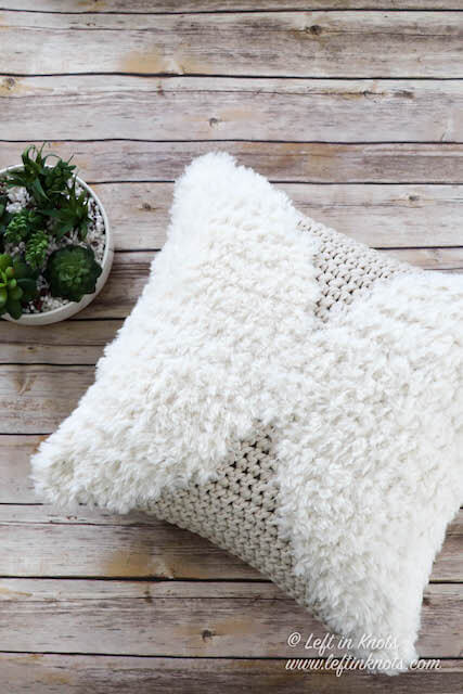 This free crochet pattern combines cotton yarn, faux fur yarn and tapestry crochet techniques to create a modern throw pillow for any decor. Made with simple single crochet stitches and double strands of yarn, this pillow is fast to make and easy enough for a beginner.