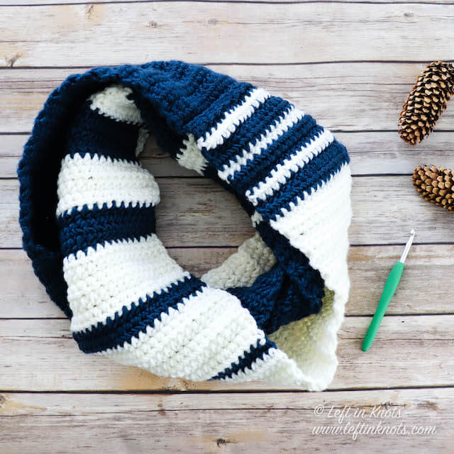 Make this fast and easy HDC infinity scarf in your favorite school or team colors! This pattern is perfect for fall football games, homecoming, super fans, new college students and more. Made with bulky Lion Brand Color Made Easy yarn, this infinity scarf is fast to make and you have a lot of color options to mix and match