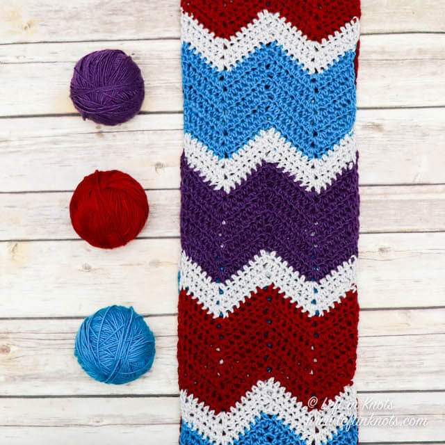 Make this jewel-toned infinity scarf using an easy HDC chevron stitch that is simple enough for even a beginner. This free crochet pattern features Whims Merino Z-twist yarn with its excellent stitch definition, beautiful sheen and vibrant colors.