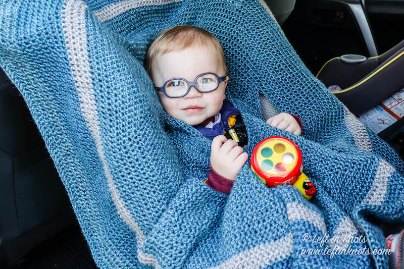 Keep your toddler warm and safe with this easy free crochet pattern! A car seat cloak can be worn safely over car seat straps AND provide an extra layer of warmth outside in the blustery cold. This pattern is beginner friendly and has a video tutorial to help you with construction.