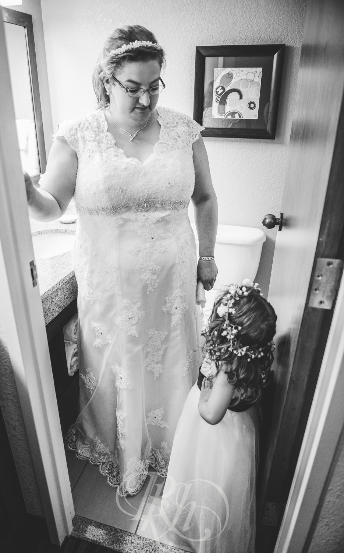 Dani & Chris - Minnesota Wedding Photographer - RKH Images - Flower Girl-1.jpg