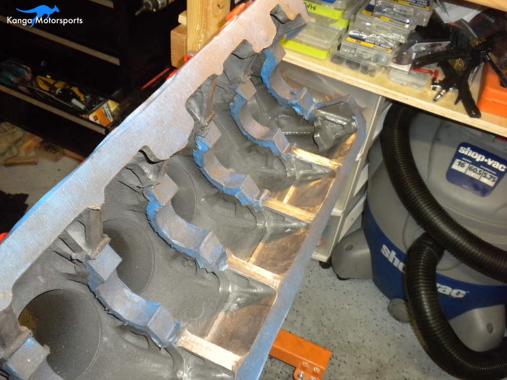 Engine Block Modifications Fine Sanding Down the Casting Finish.JPG