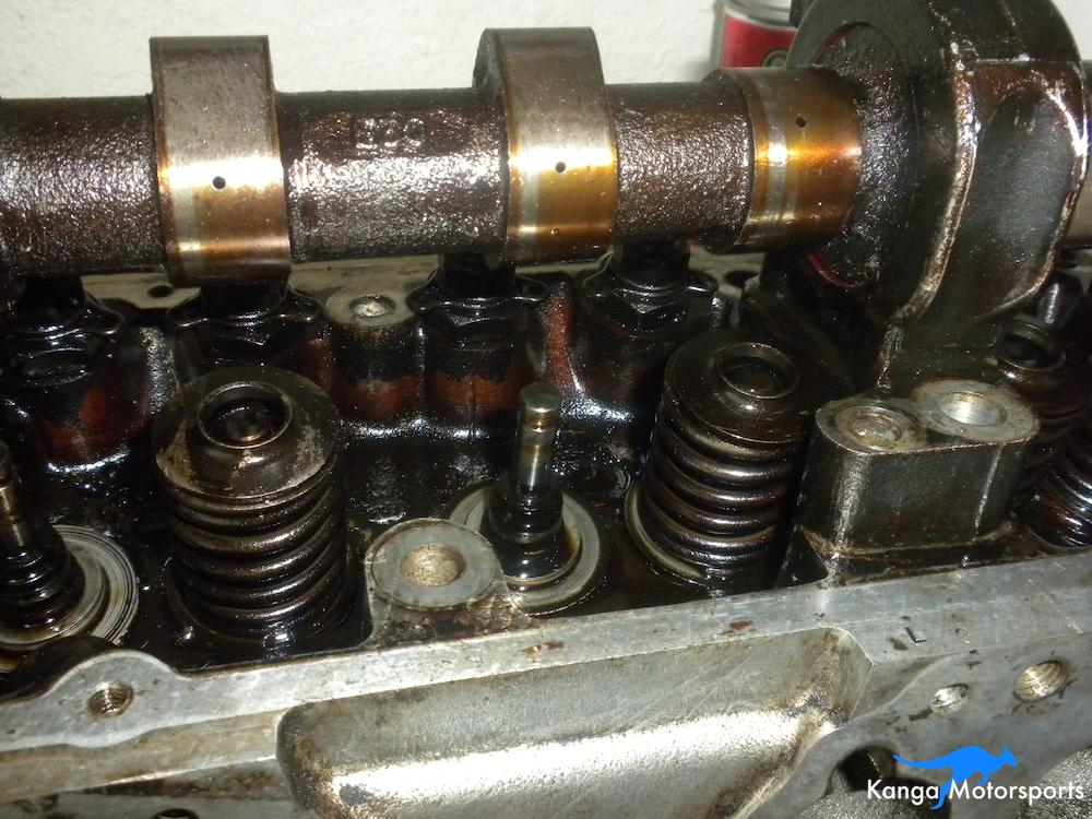 Removing Springs Datsun Cylinder Head.JPG