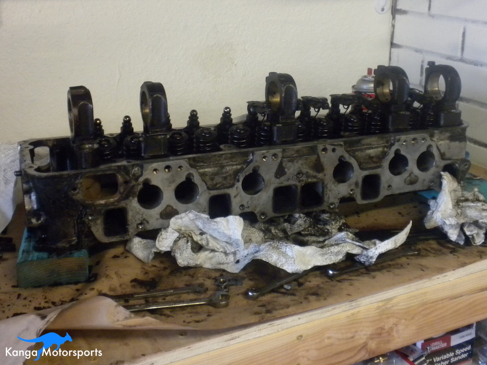 Cleaning off the gunk Datsun Cylinder Head.JPG