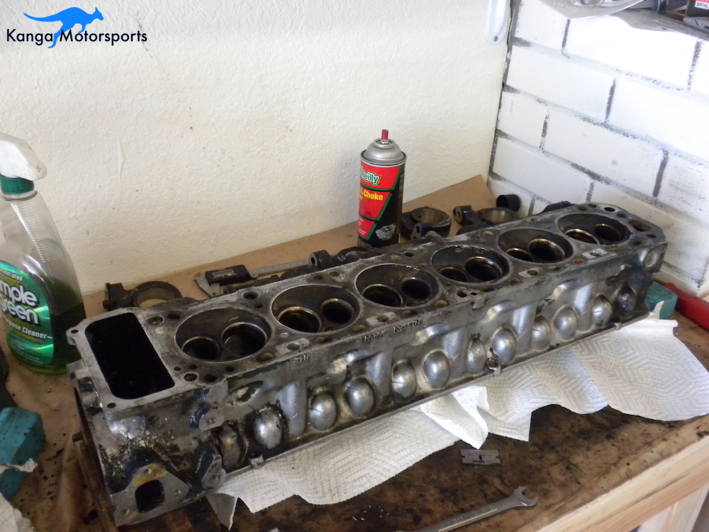 Disassembled Datsun Cylinder Head Chambers.JPG
