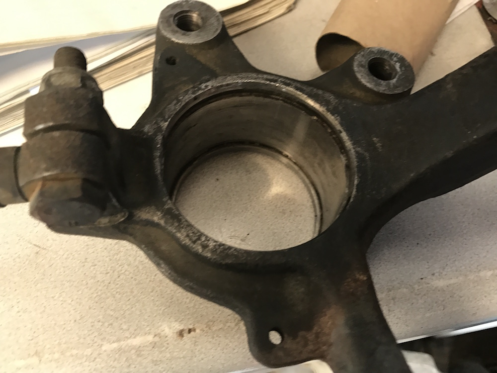 Spec Racer Ford Wheel Bearing and Hub Replacement Clean Out Upright.JPG