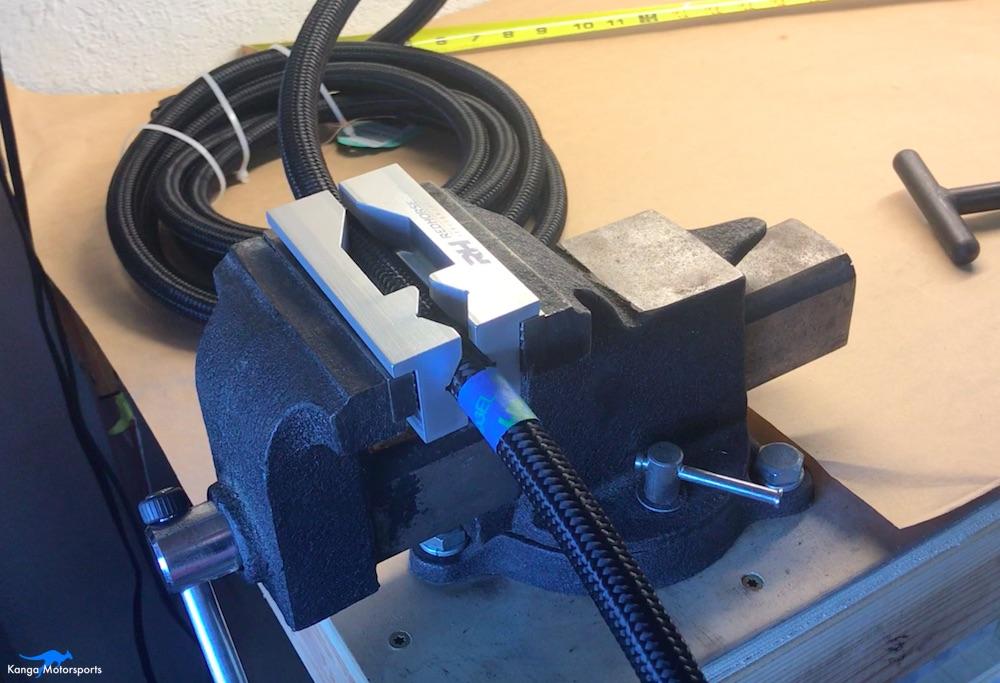 Kanga Motorsports AN fittings load hose in vise masking tape.jpg