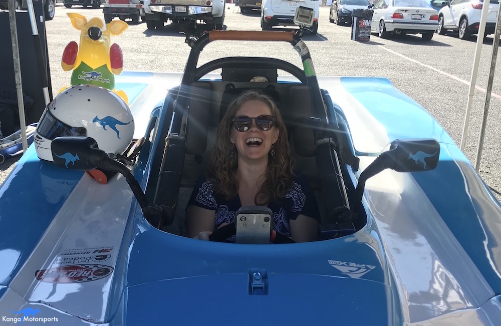 Laura enjoyer her time sitting in the race car.