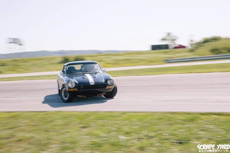 Michael Beck of  Ten Tenths Podcast  drifting his Fiat 124 Sport Spider.