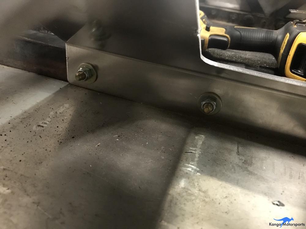 Kanga Motorsports ButlerBuilt Seat Spec Racer Ford Gen3 Tighten Lower Mounting Bracket Fasteners.JPG