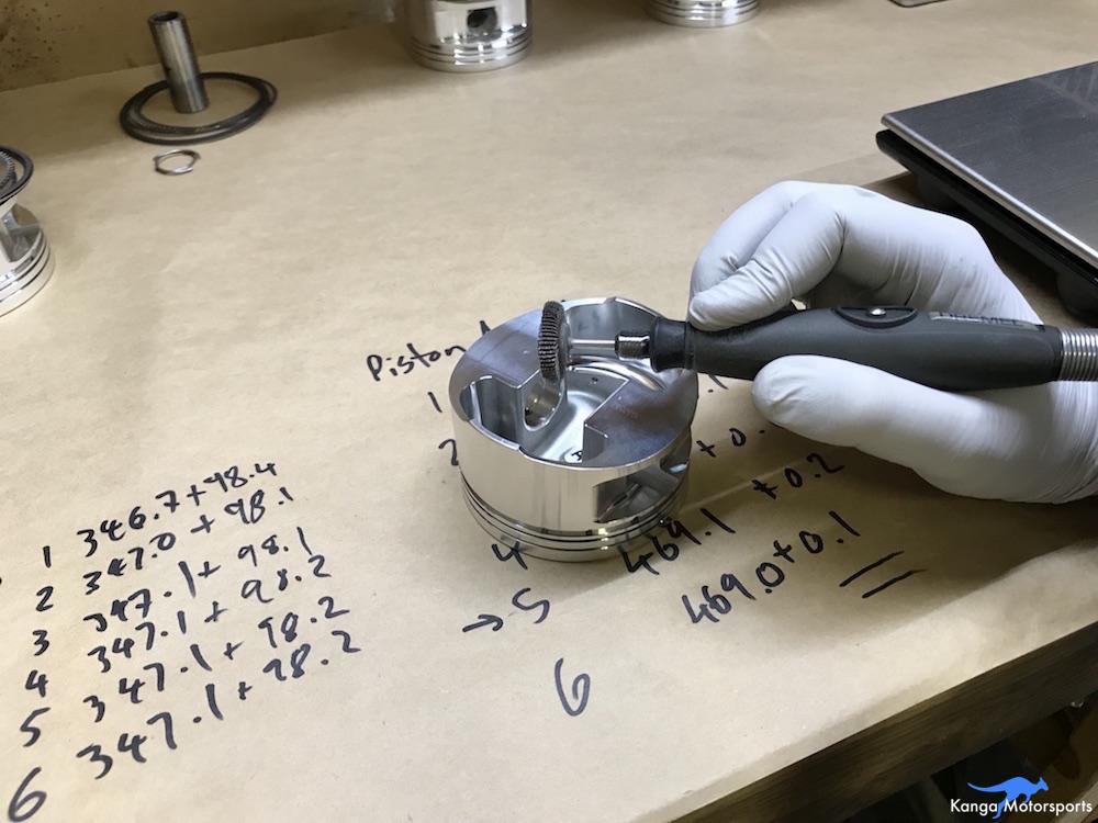 Kanga Motorsports Datsun 240z Engine Build Piston Balancing Removing Material.JPG