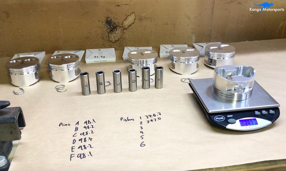 Kanga Motorsports Datsun 240z Engine Build Piston Balancing Weighing Pistons.jpg