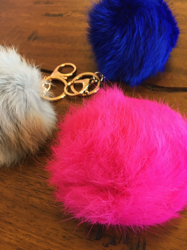 Fuzzy key chains!  First seen on the runways for Fendi, with a price tag of $3,000!  The likes of Kendall Jenner, Gigi Hadid, and Taylor Swift have made these little cuties a must have.