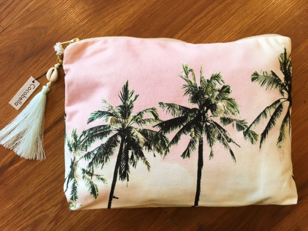 "By Cocobella.  This size is the ""pouch"" size.  It can hold your iPad, or makes for the perfect beach accessory."