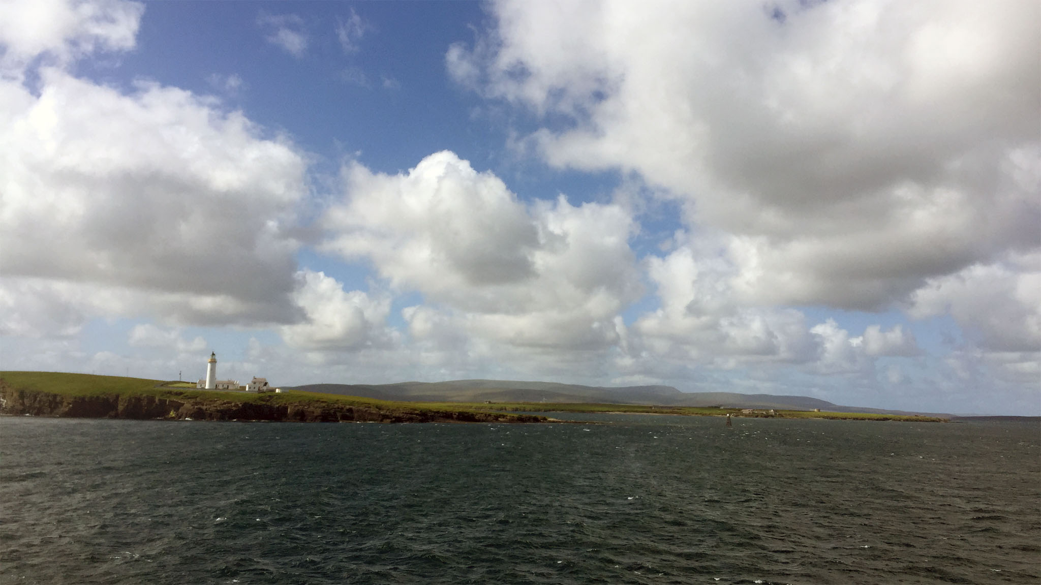 Rounding Cantick Head, with Scapa Floe and the Hoy Hills beyond, aboard MV Hamnavoe (photo: Aaron Watson)
