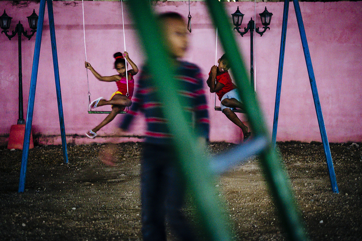 Kids play at a public playground in Centro Havana.