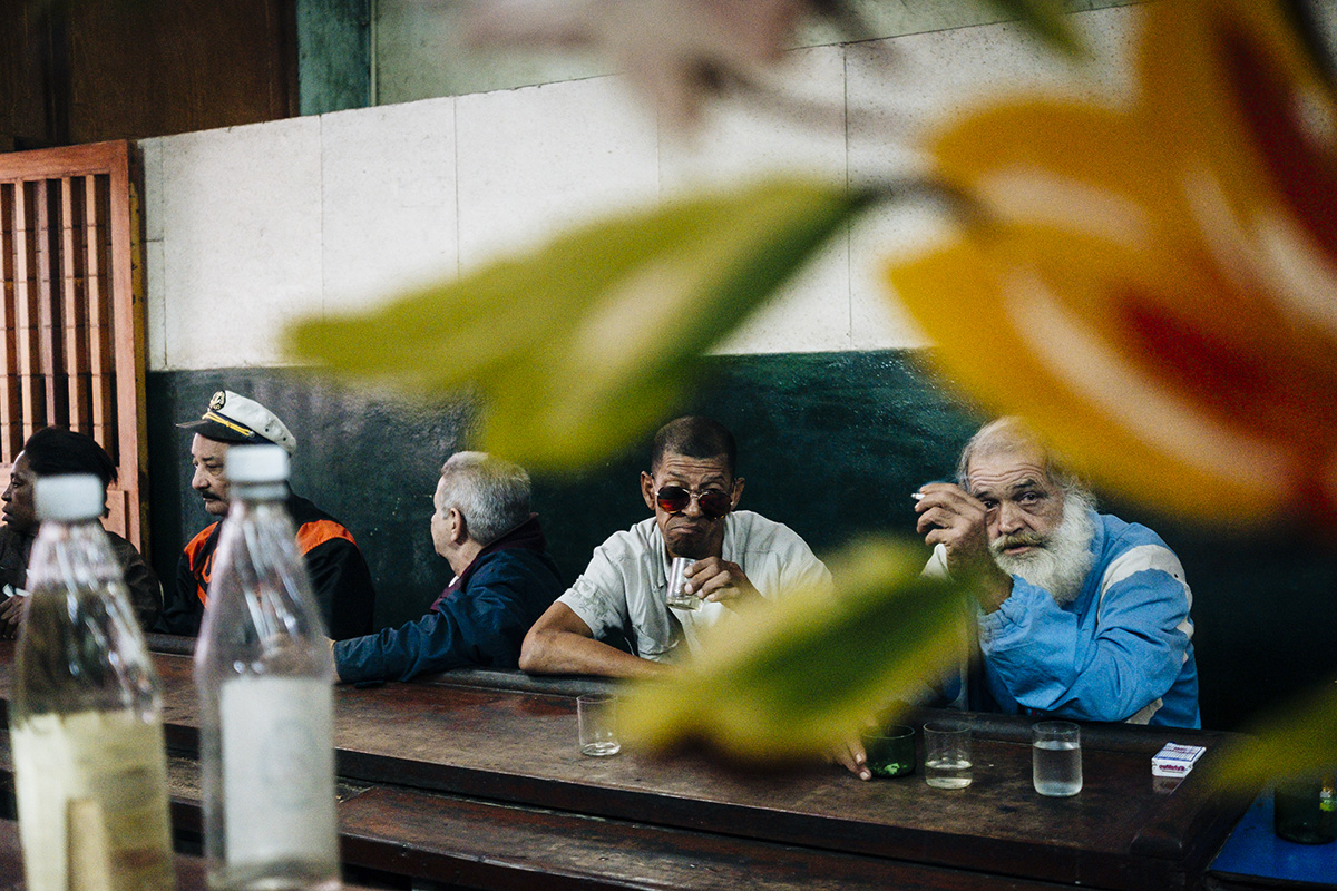 Cubans drink and smoke in a bar in Centro Havana.