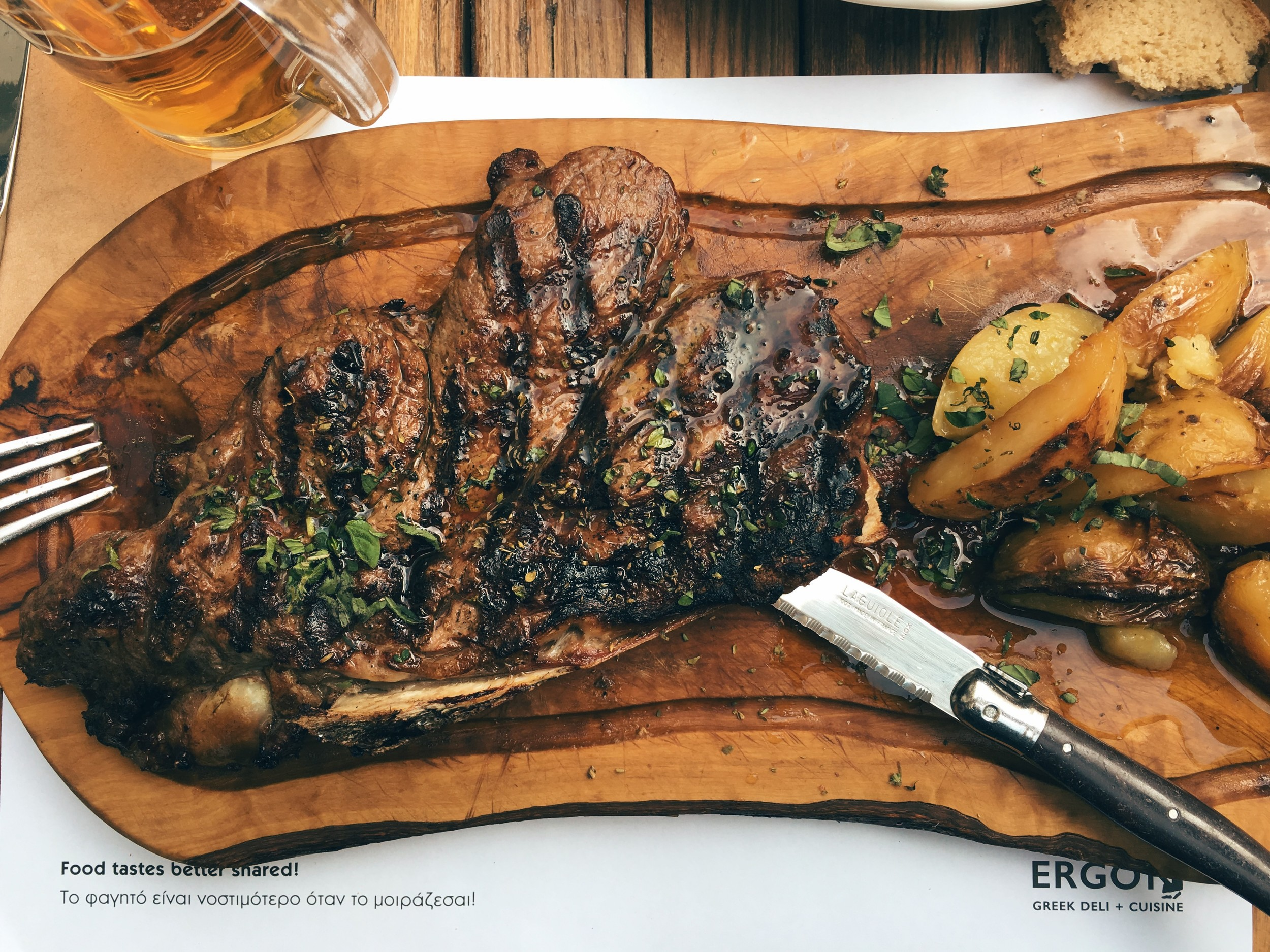 Rib-eye steak with oven potatoes, served with a touch of truffle oil. Served at Ergon