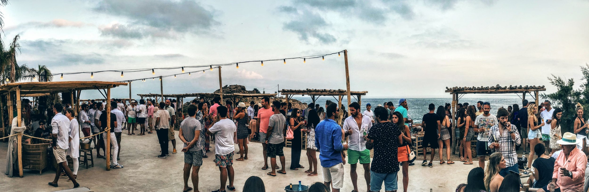 Crowds flock in early before sunset at Scorpios on Sneaky Sundays